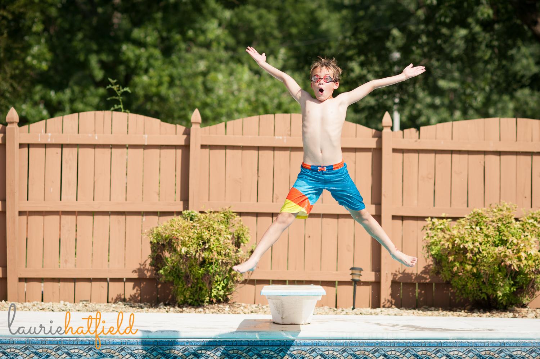 boy jumping off diving board   Huntsville family photographer