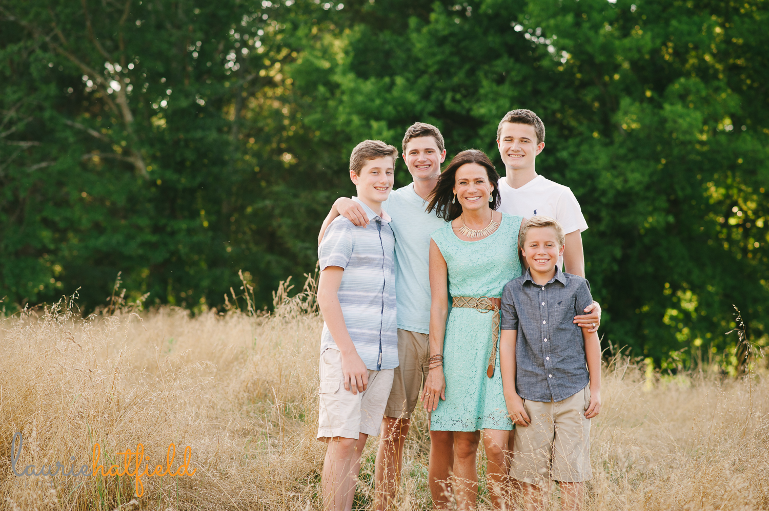 mom with four sons in field | Huntsville family photographer