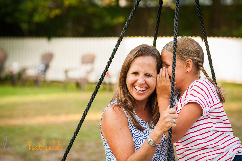 mom and daughter telling a secret | Huntsville family photographer