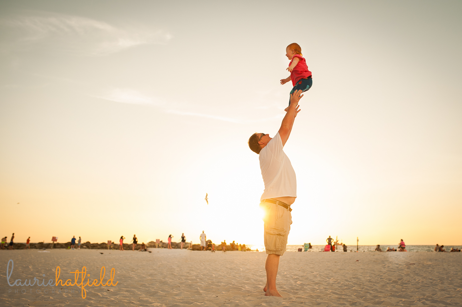 dad and 2-year-old daughter on beach | Huntsville photographer