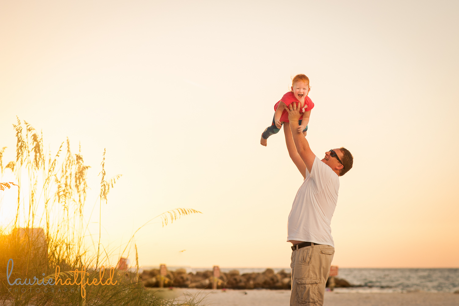 dad holding daughter on beach | Huntsville family photographer