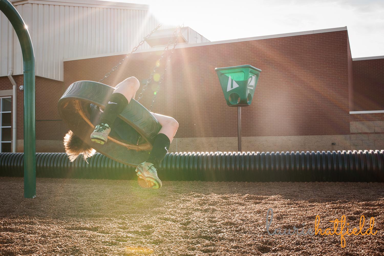 boy on tire swing in sunlight | Huntsville photographer