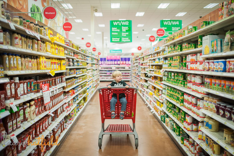 little boy in shopping cart | Huntsville family photographer