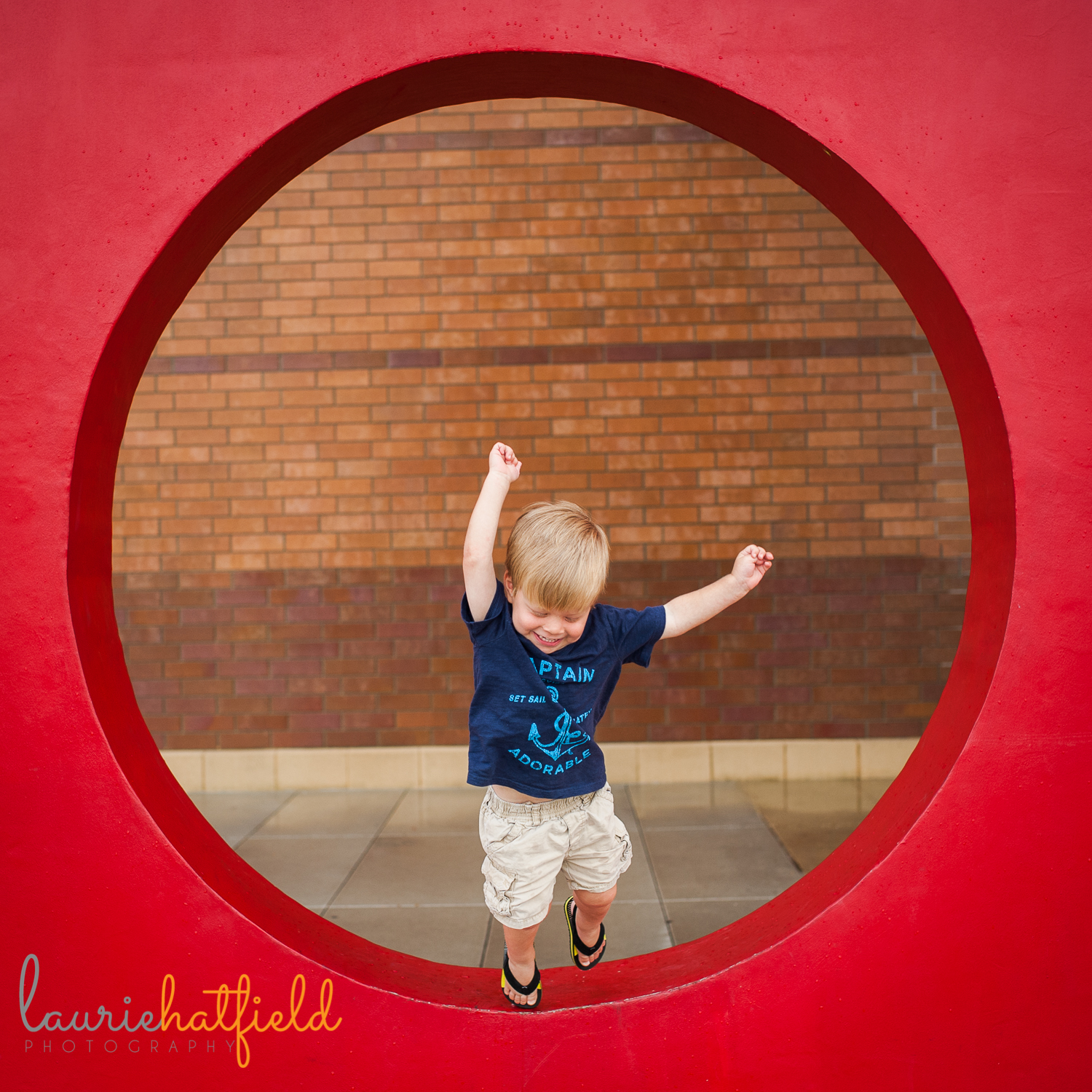 little boy jumping in red circle | Huntsville family photographer