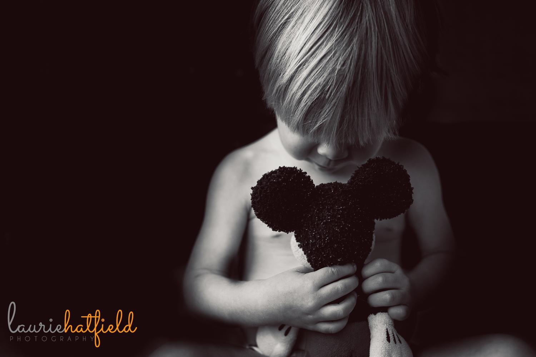 little boy holding Mickey Mouse | Huntsville family photographer