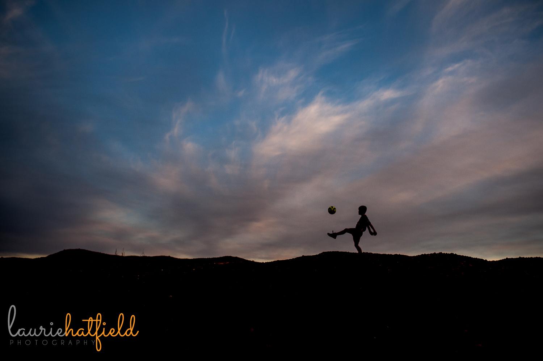 silhouette of boy and soccer ball | Huntsville family photographer