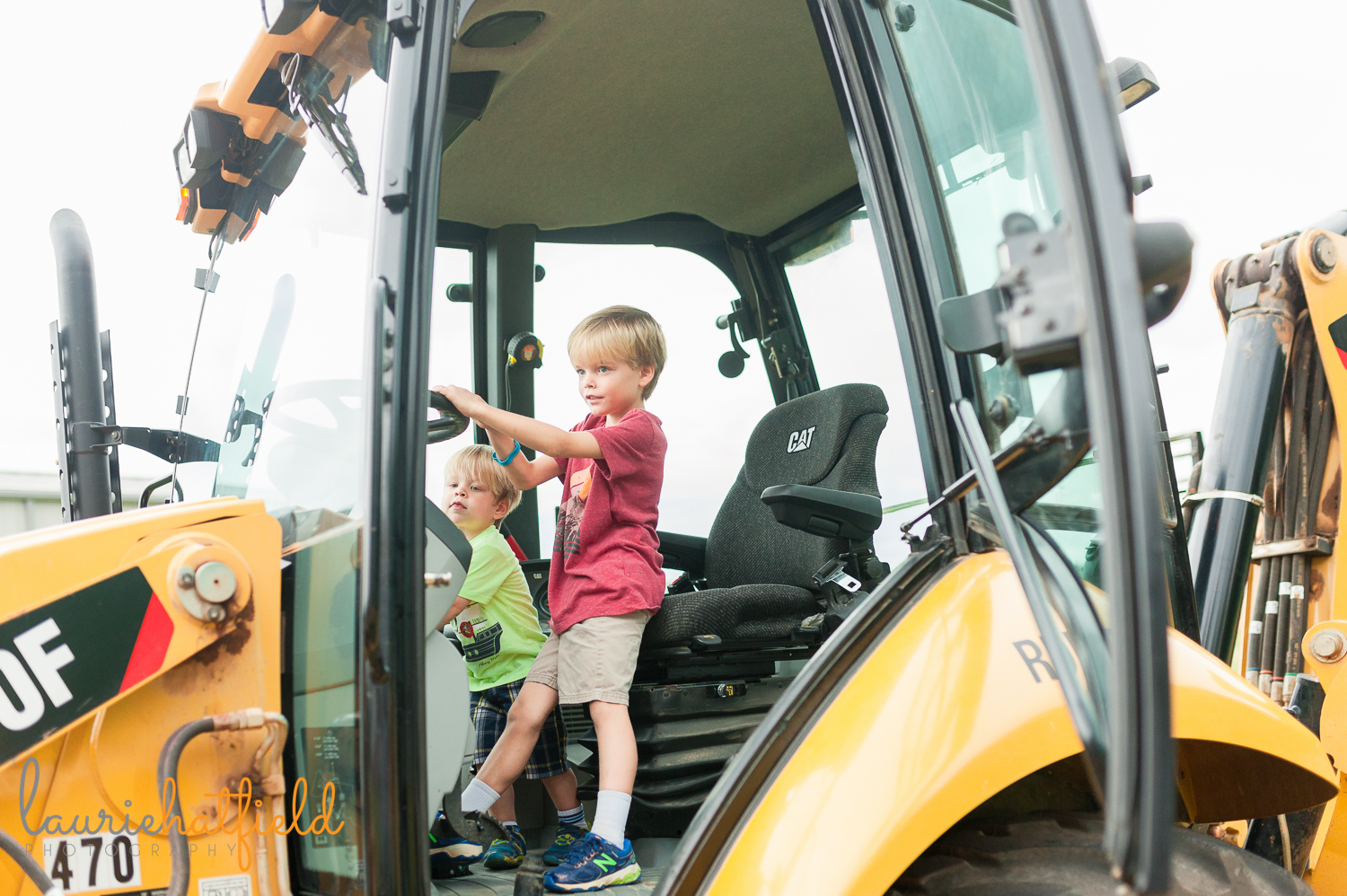 2 brothers sitting in cab of backhoe | Huntsville family photographer