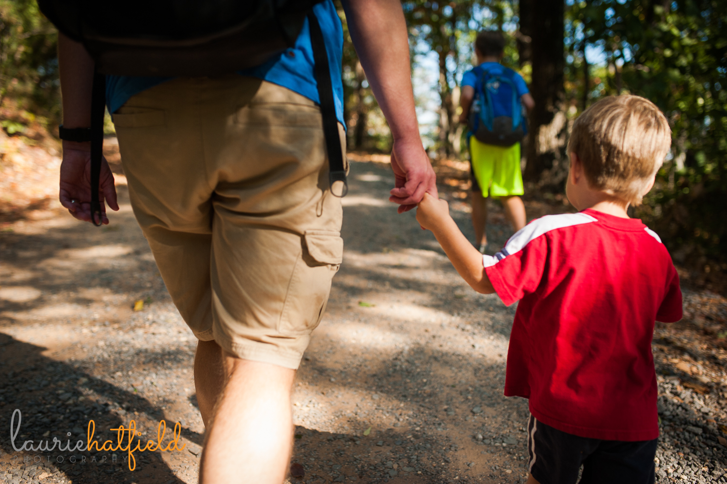boy hiking in woods with dad | Huntsville AL family photographer