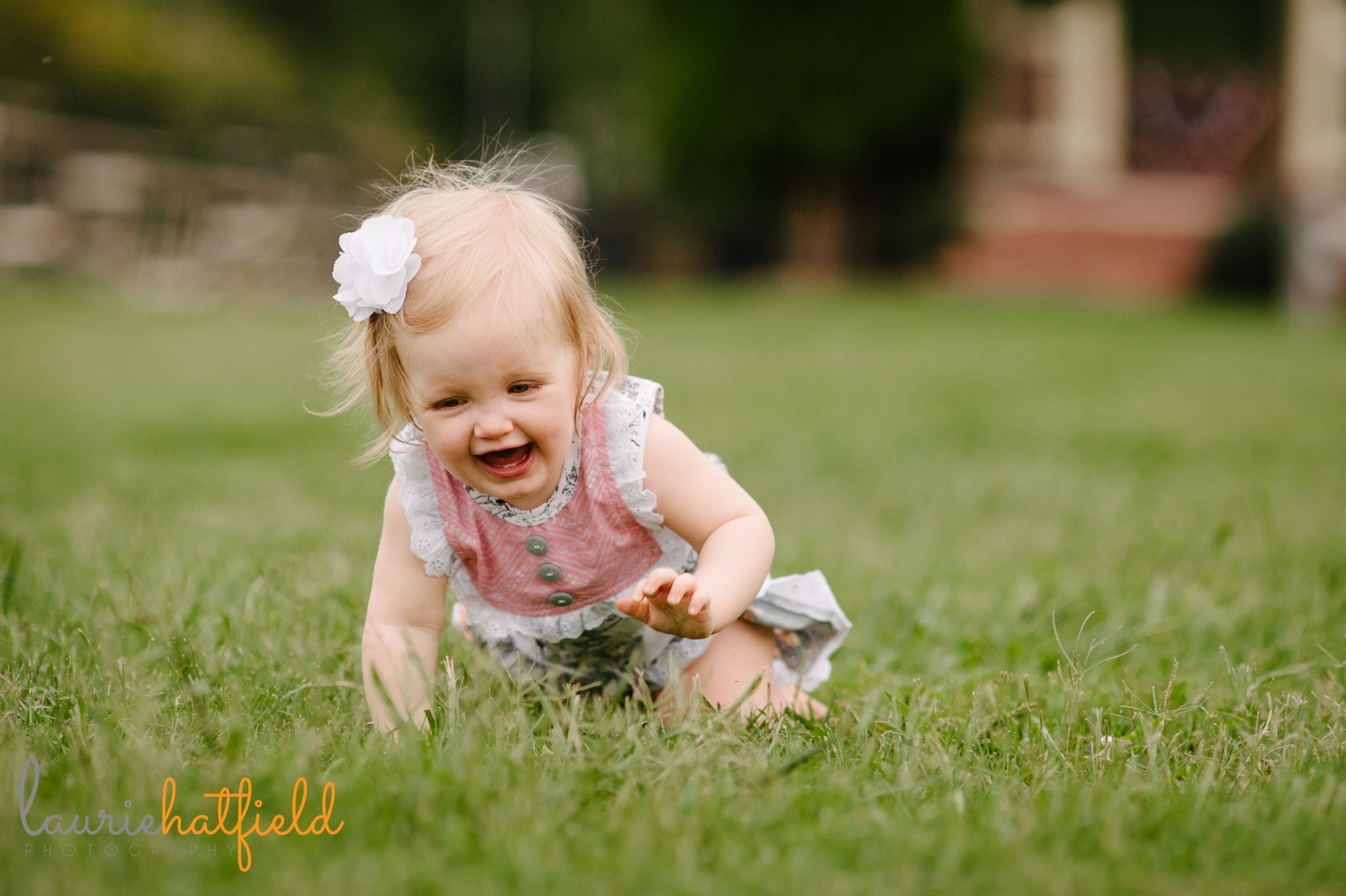 baby girl crawling in grass   Mobile AL family photographer
