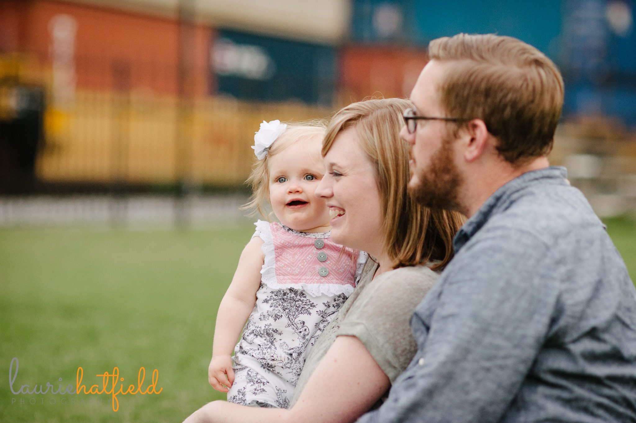 family of 3 watching trains   Mobile AL lifestyle photographer