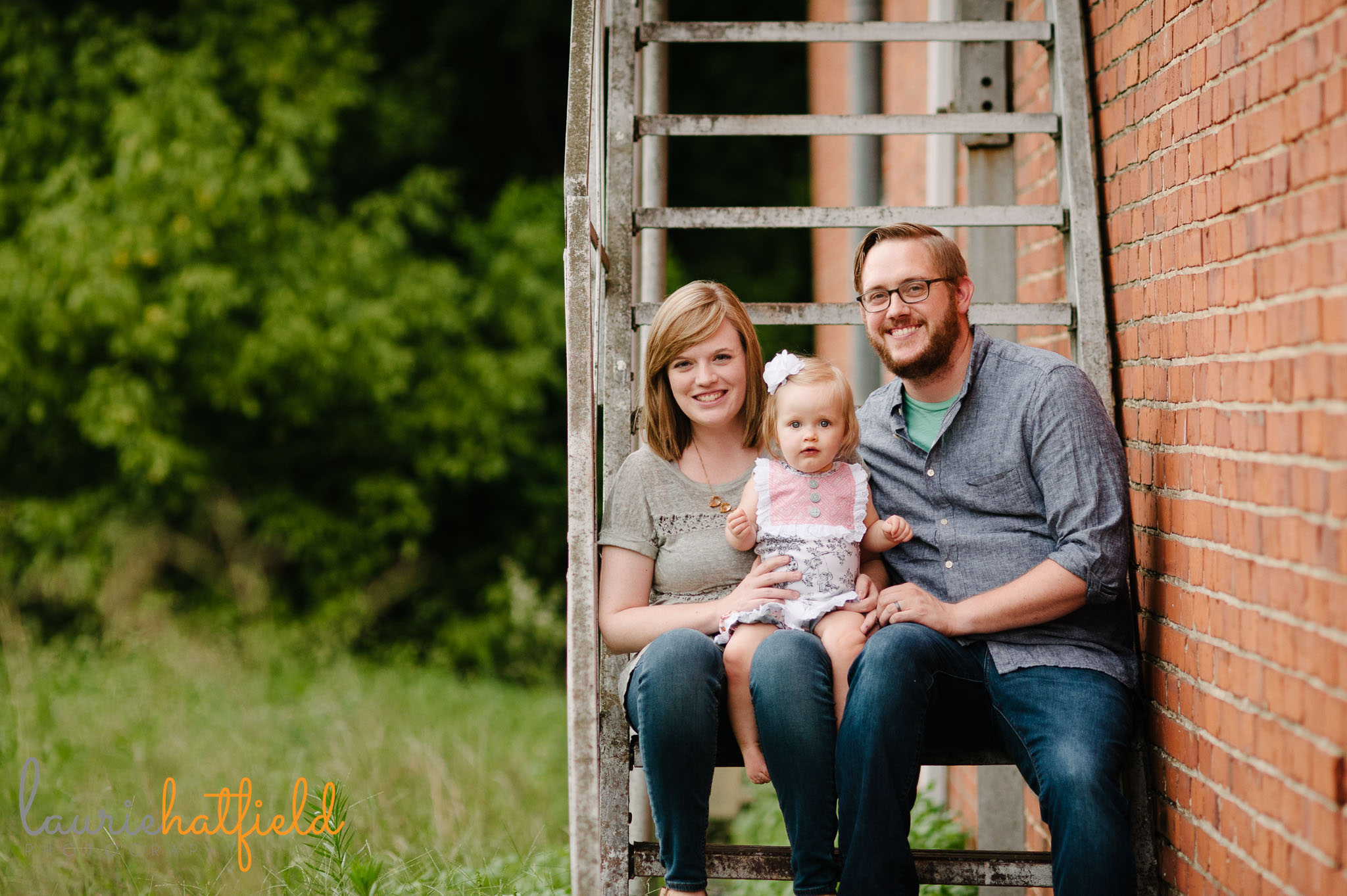 family of 3 sitting on stairs   Mobile AL lifestyle photographer