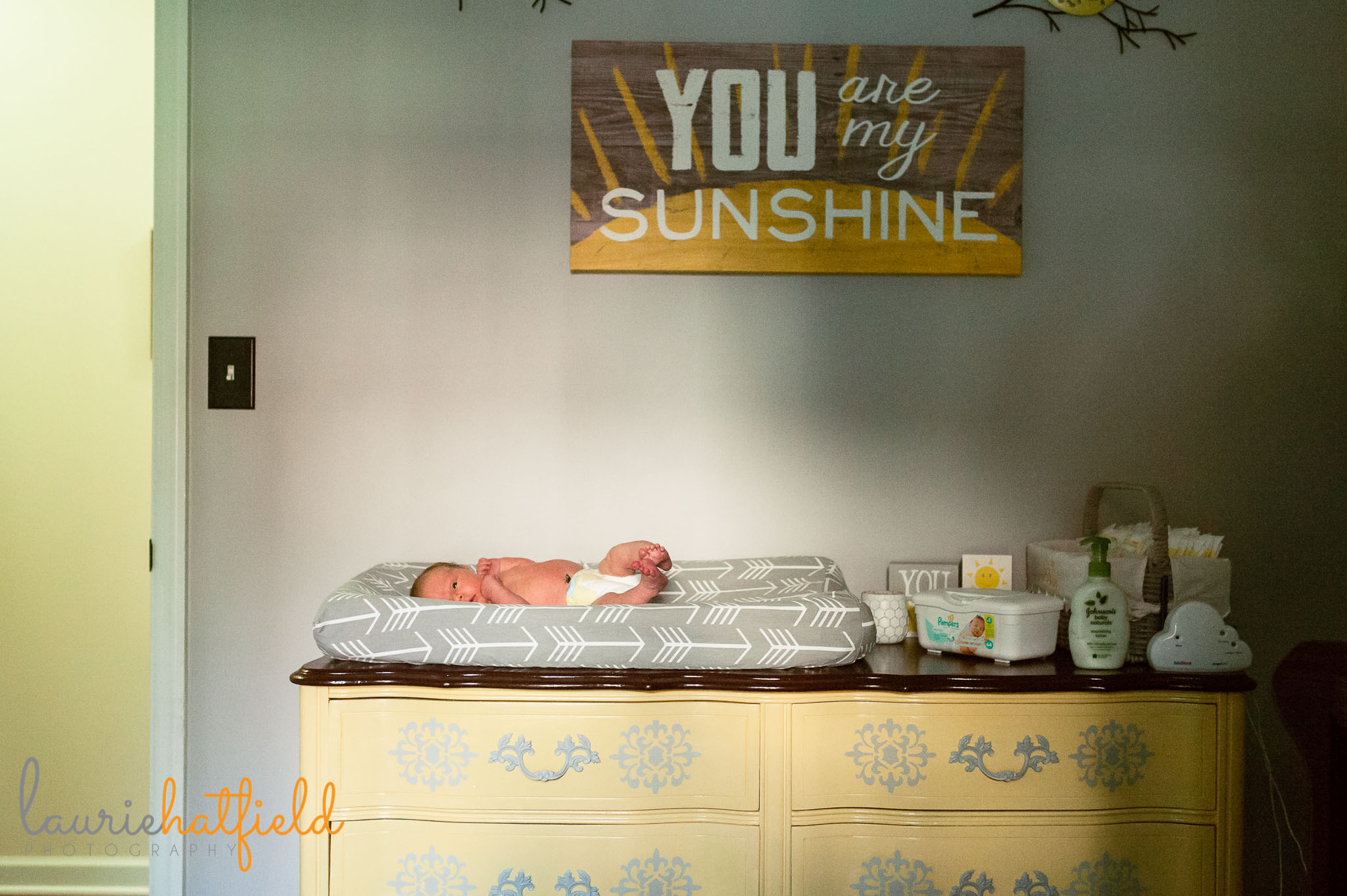 baby girl in nursery | Mobile AL lifestyle newborn photographer