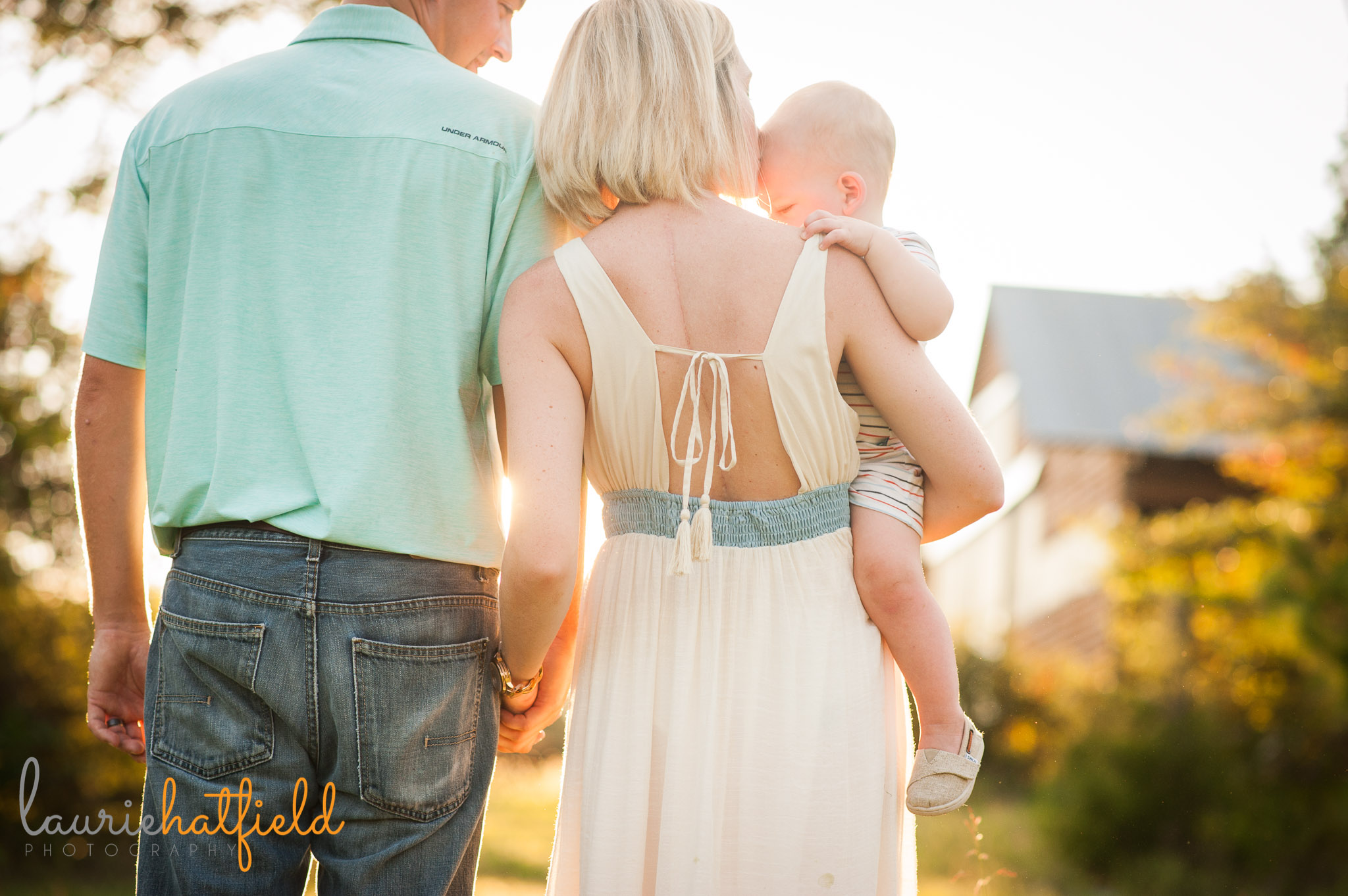 back of family of three in field | Mobile AL photographer