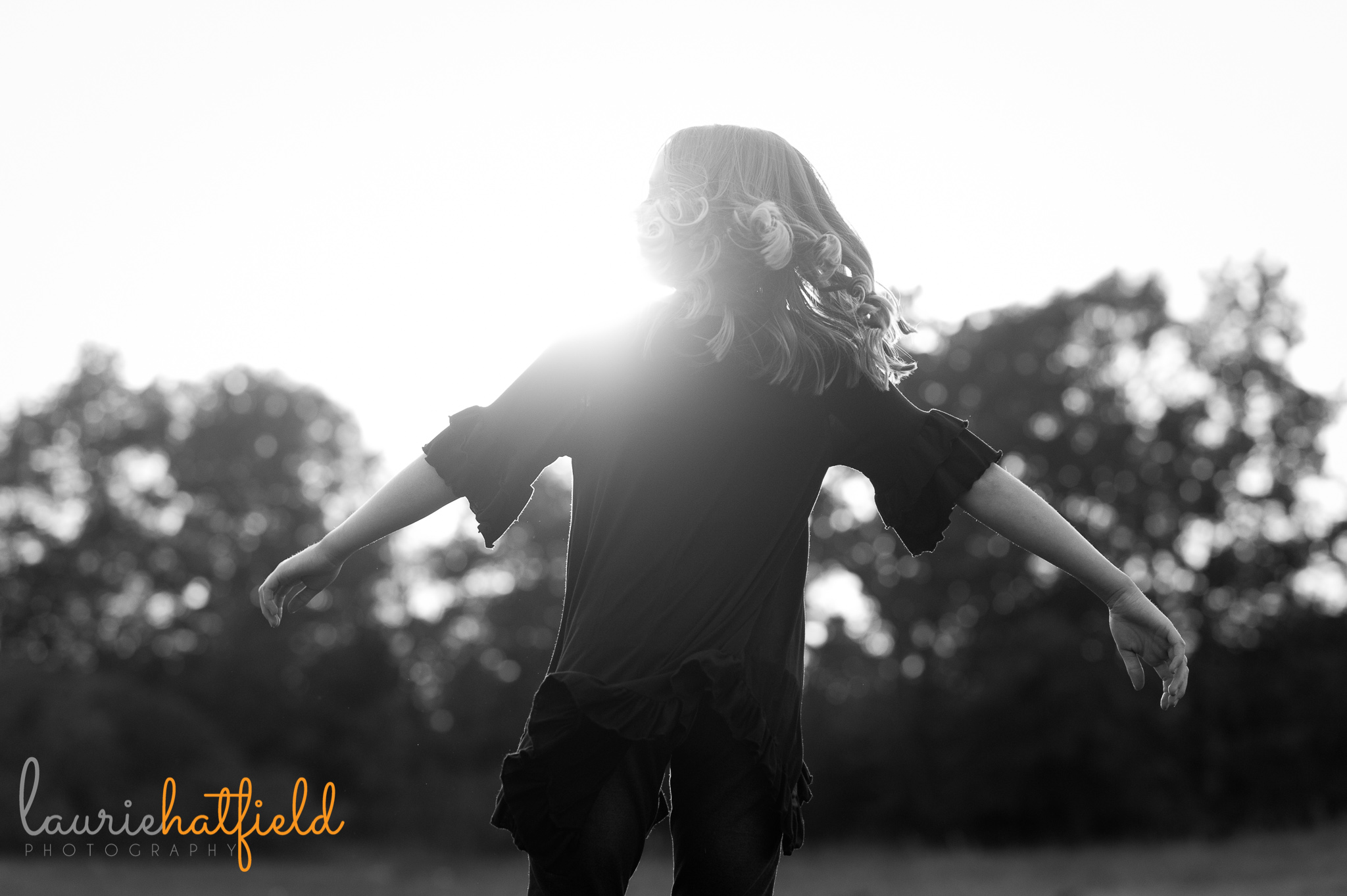 girl dancing in field | Mobile AL family photographer