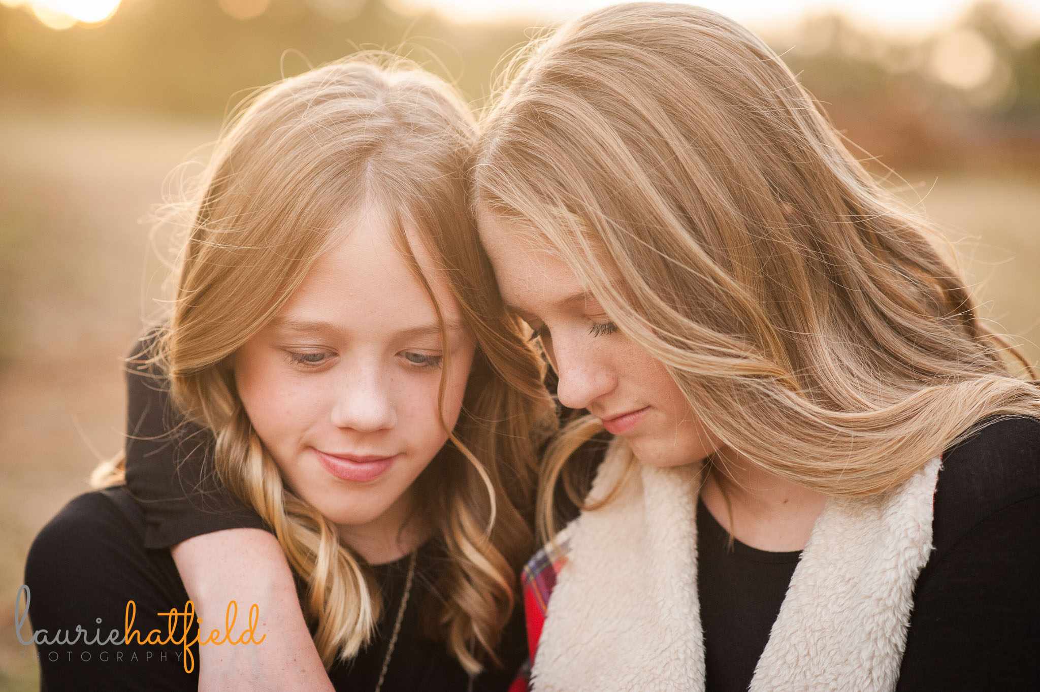 sisters with arms around each other | Mobile family photographer