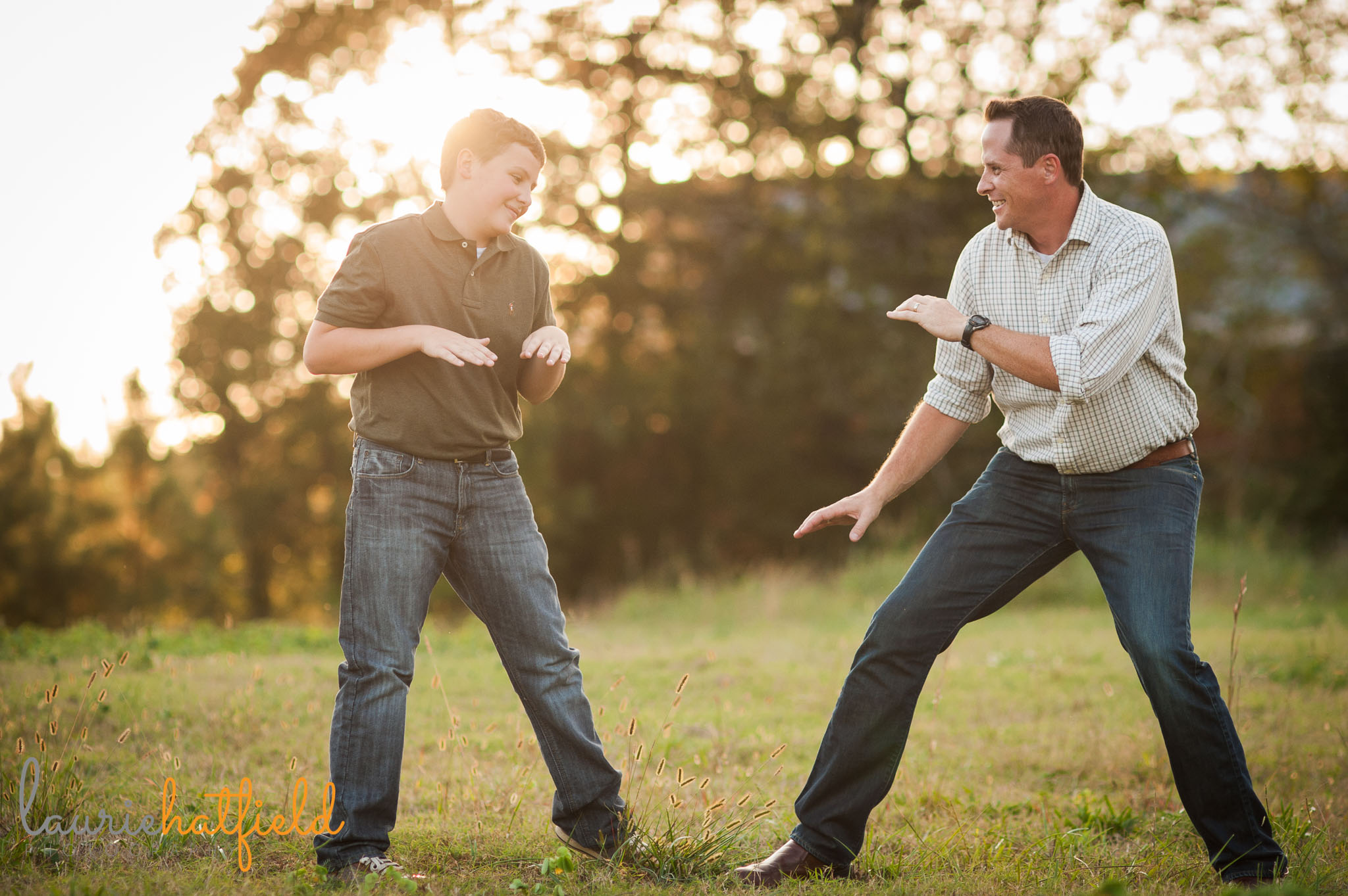 dad and son playing karate in a field | Mobile family photographer