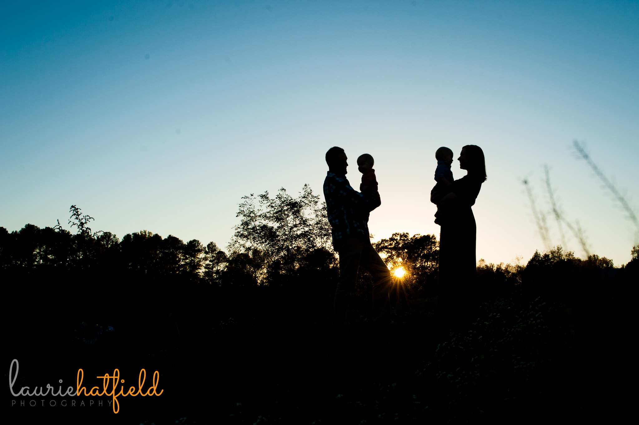 silhouette of family of four   Mobile AL photographer