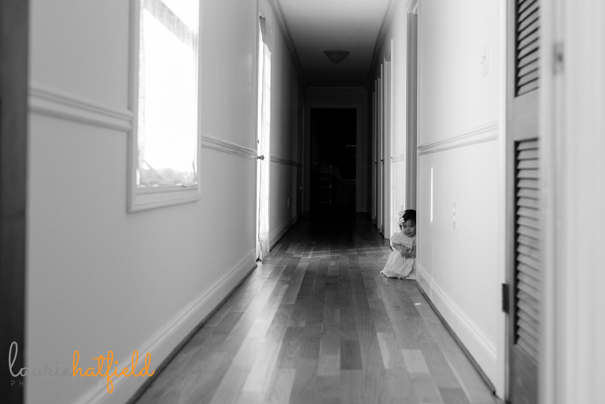 little girl in hallway | Mobile newborn photographer