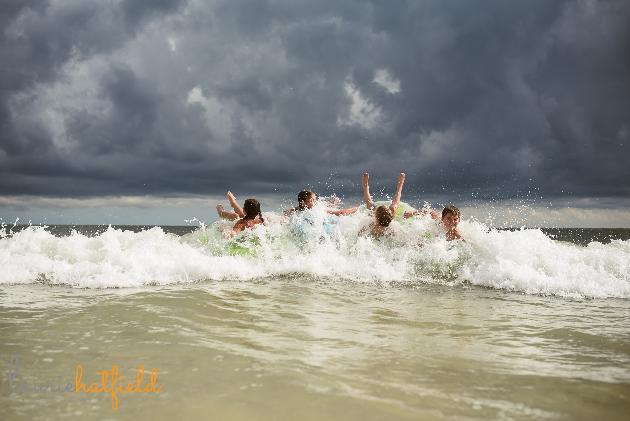 4 kids playing on floats at the beach | Mobile AL family photographer