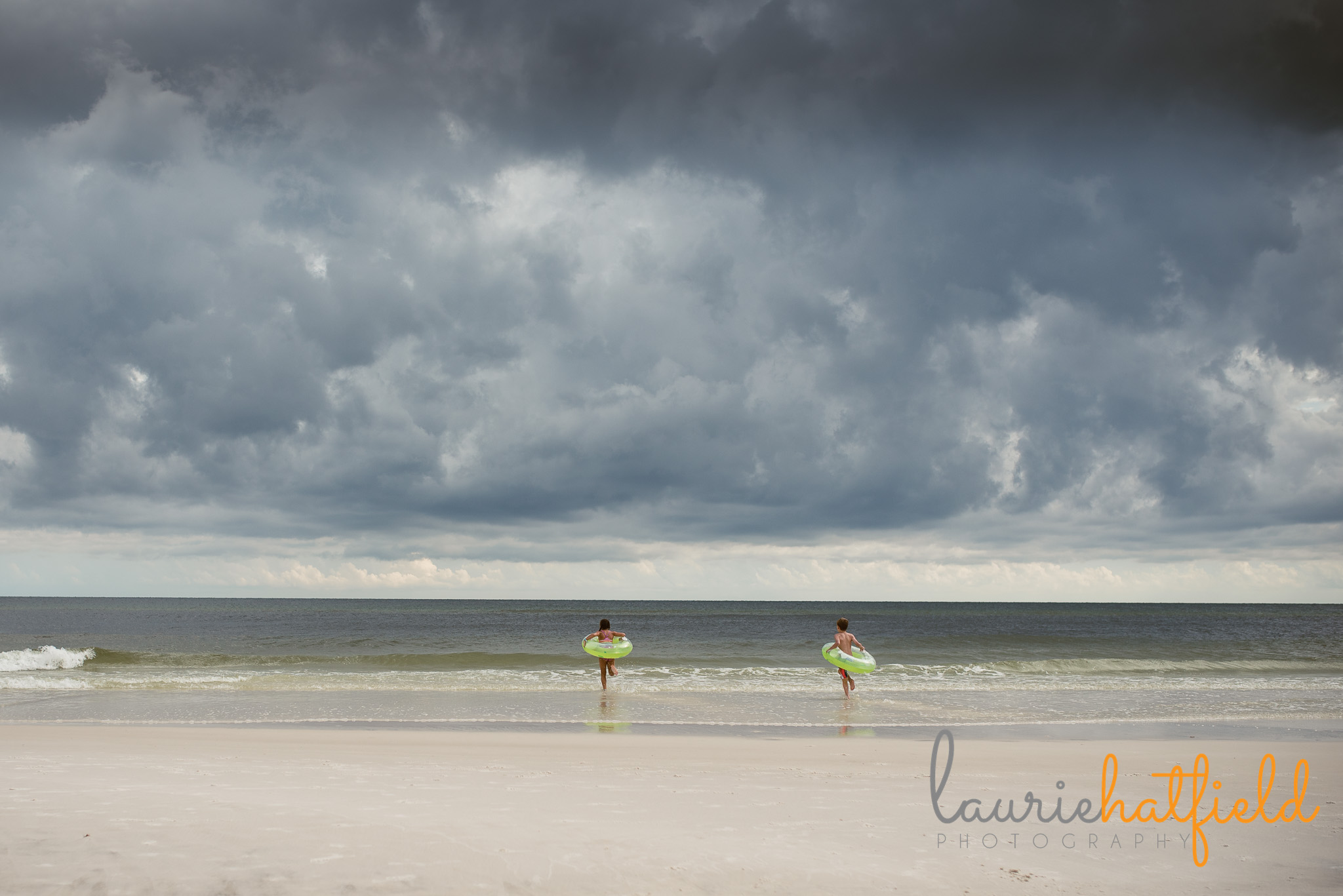 2 kids running towards ocean | Mobile AL family photographer