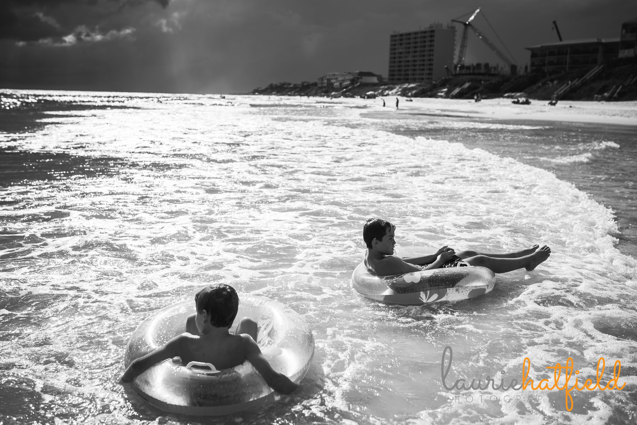 2 boys on floats on the beach | Mobile AL family photographer