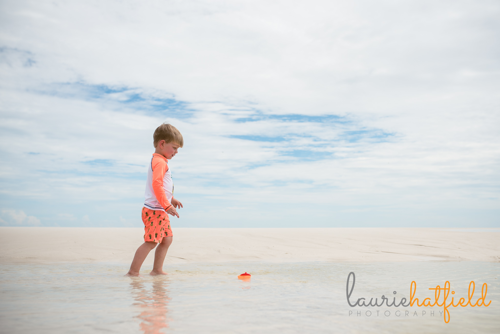 little boy walking in water on the beach | Mobile AL family photographer