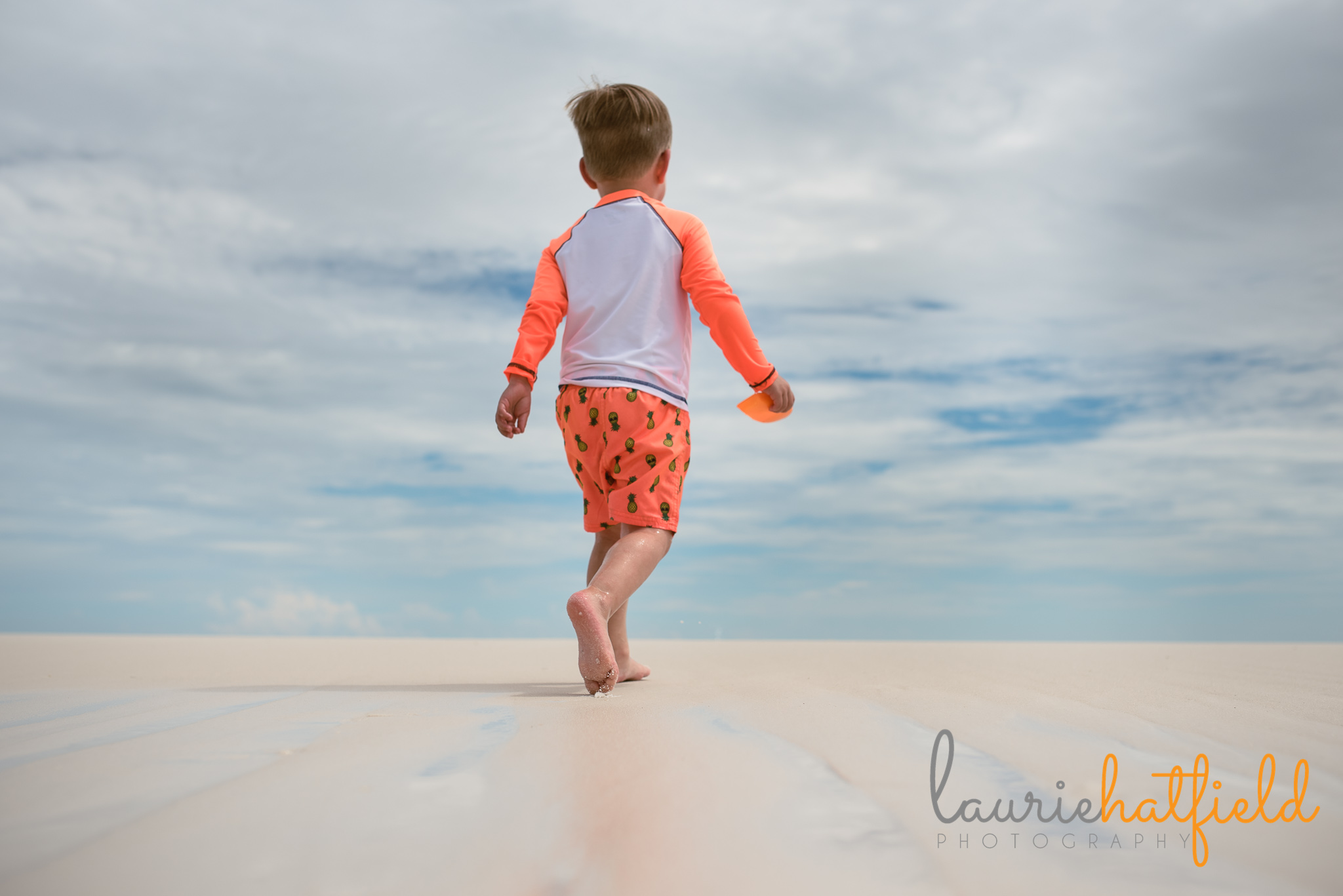 little boy walking on the beach | Mobile AL family photographer