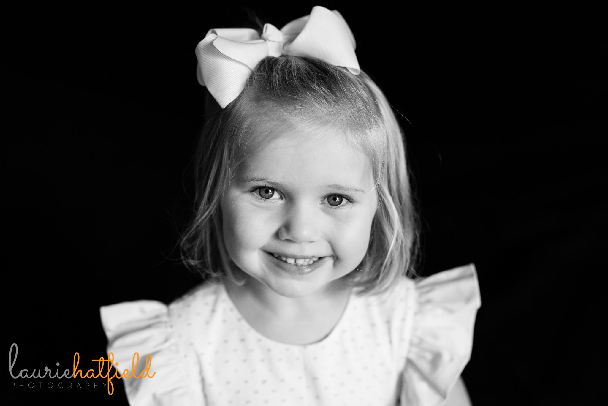4-year-old girl smiling   Mobile AL school portrait photographer