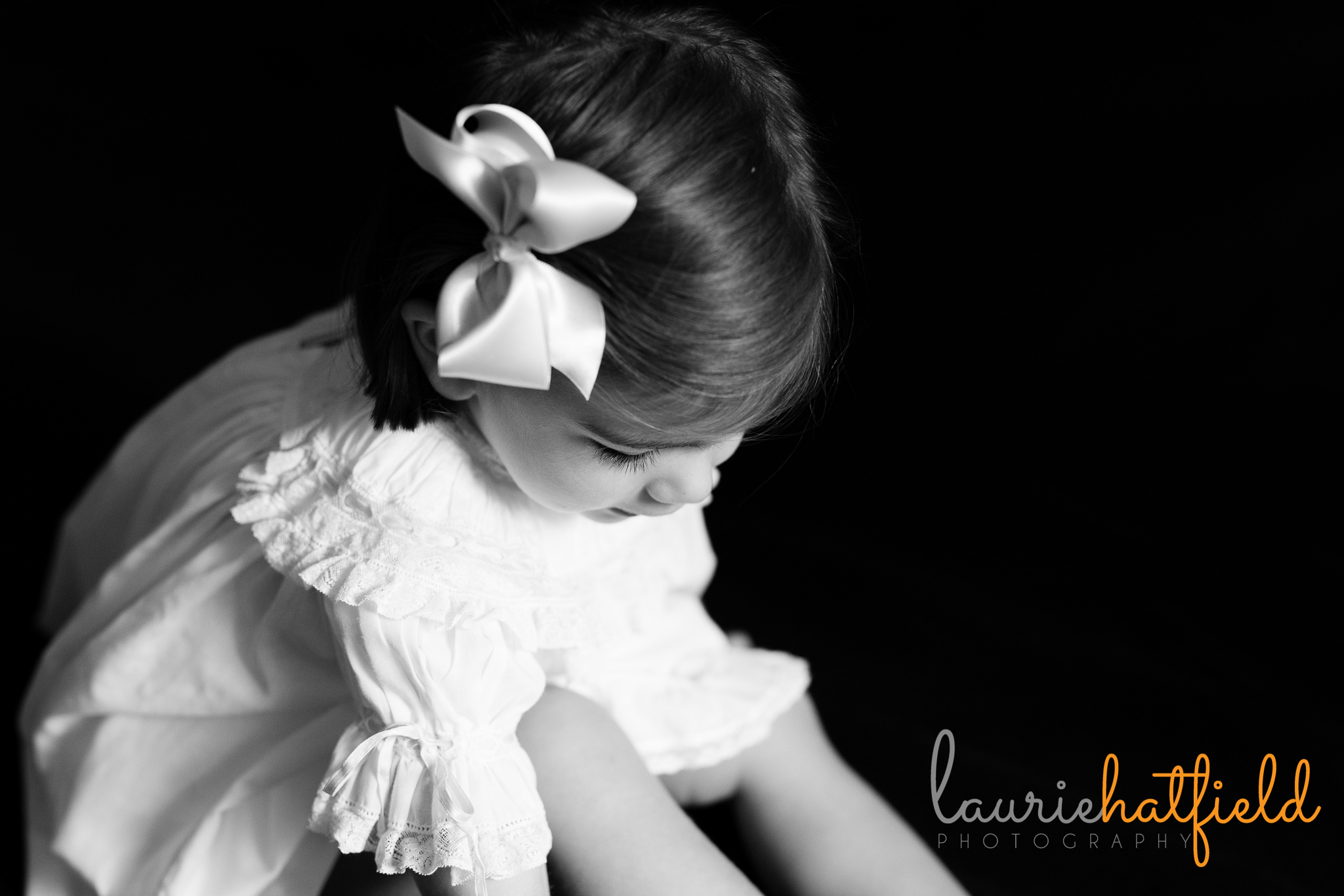2 year old girl in dress looking down | Mobile al preschool portraits