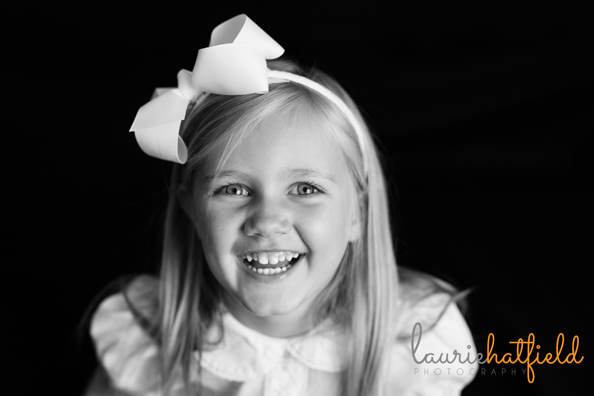 little girl laughing with headband | Mobile AL preschool photographer