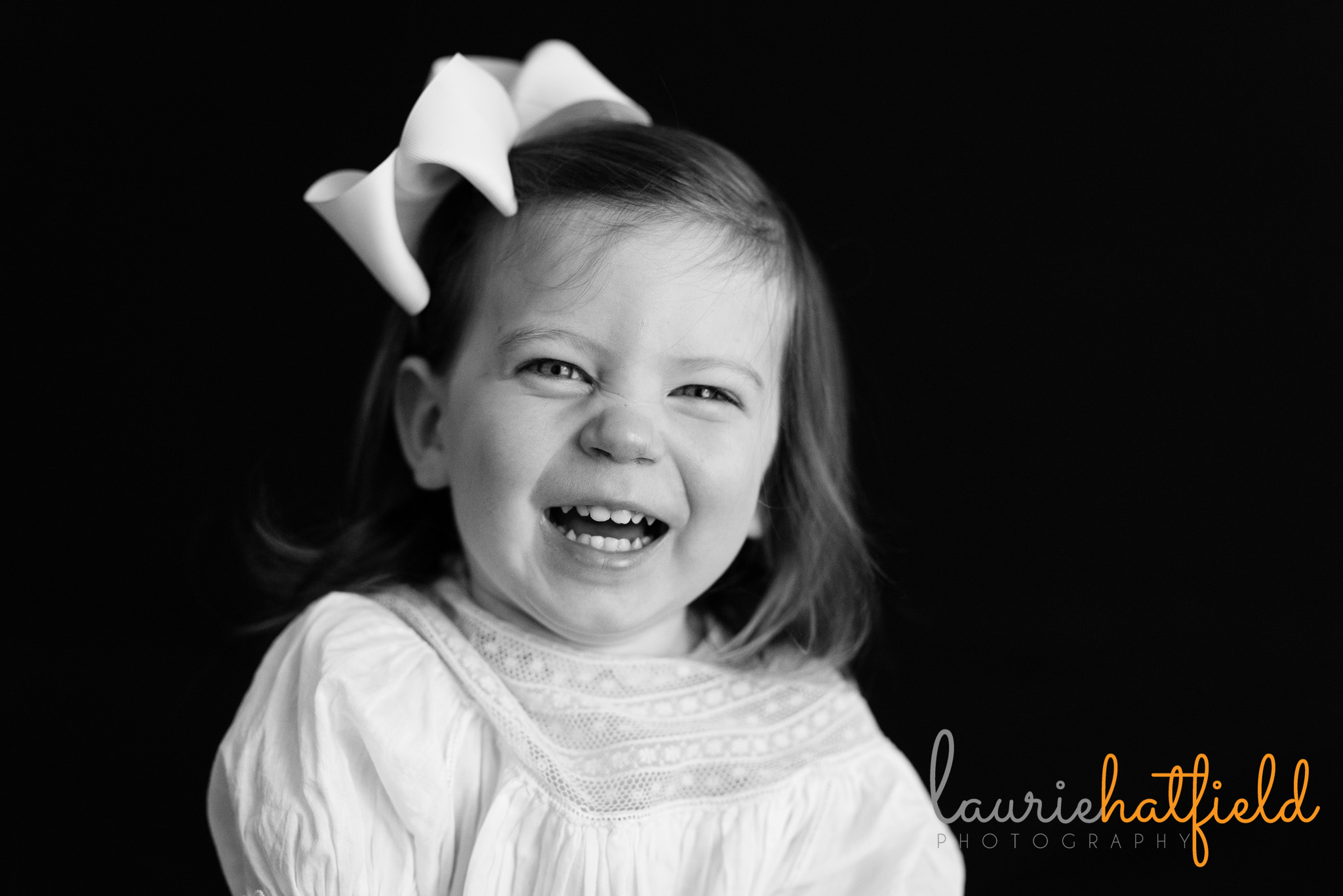 2-year-old girl laughing | Mobile AL school portrait photographer
