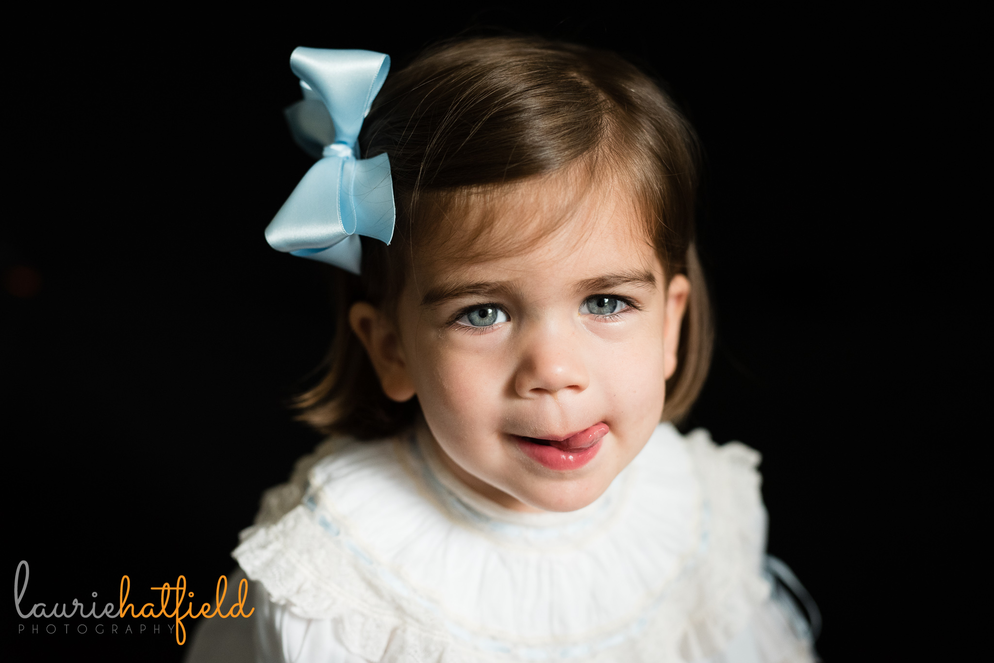 little girl with tongue sticking out | Mobile AL preschool photographer