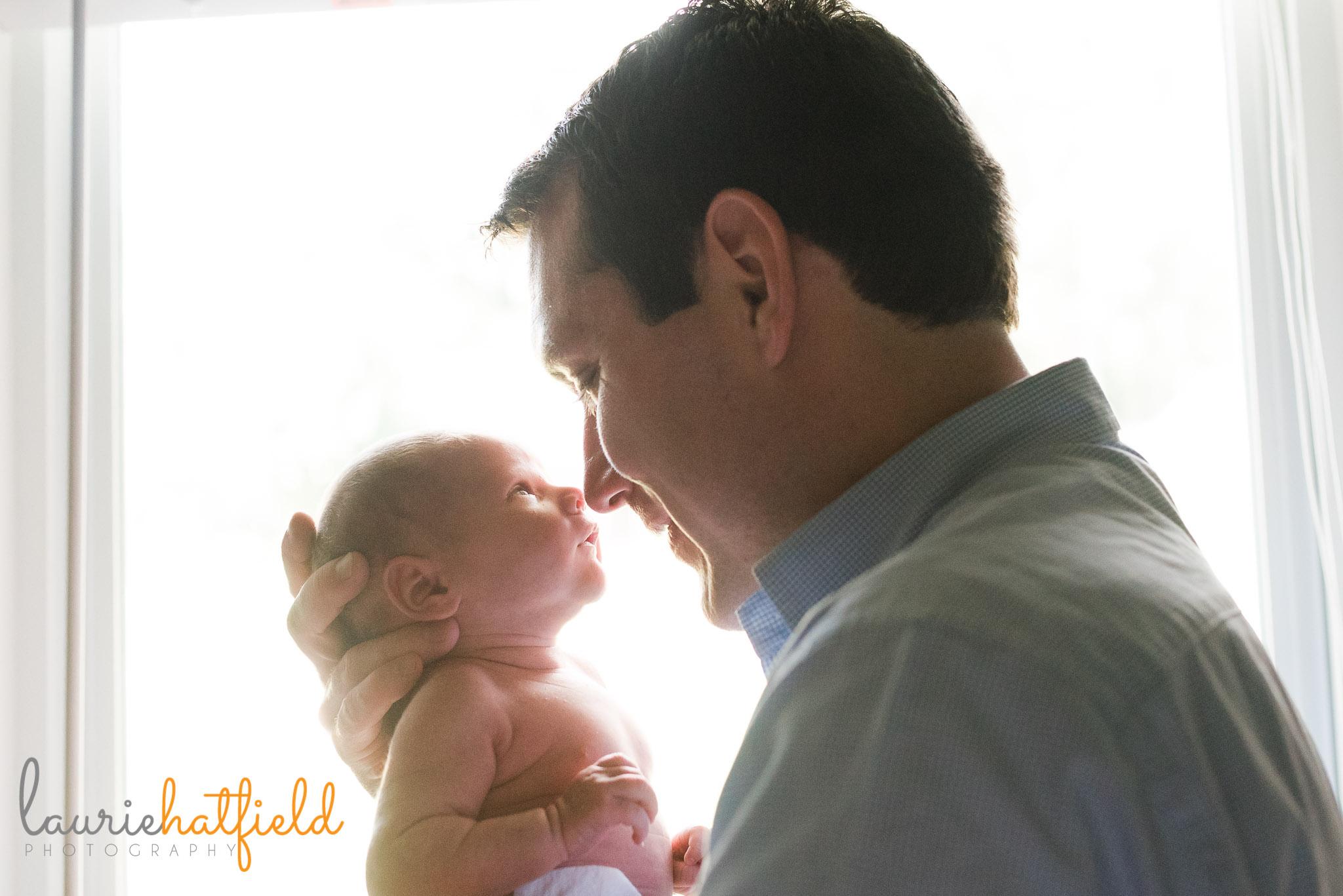 dad snuggling new baby boy | Mobile AL newborn photographer