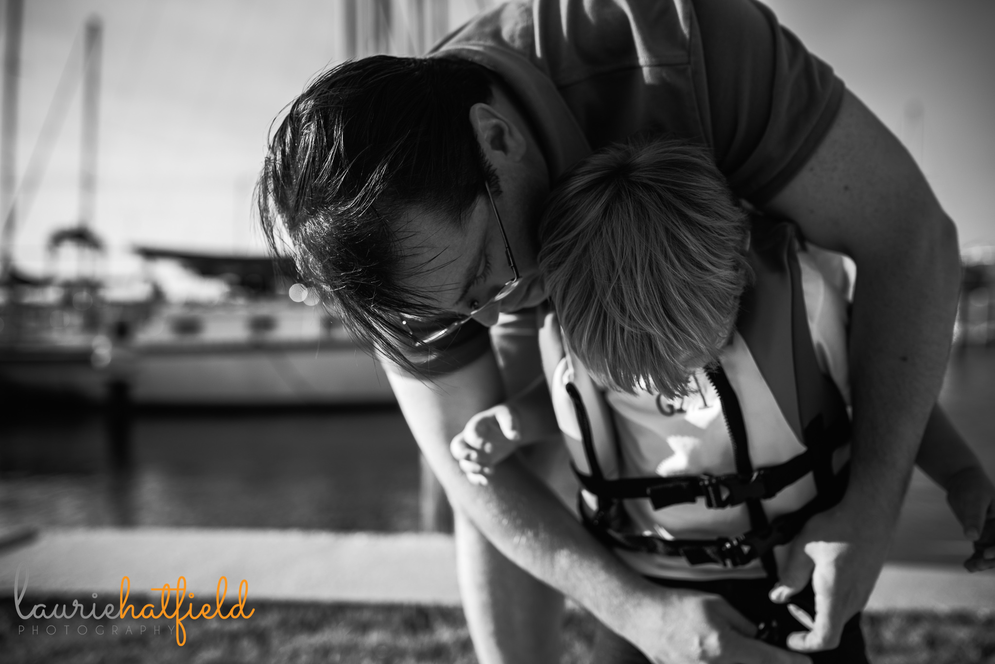 dad helping son put on life jacket | Mobile AL family photographer