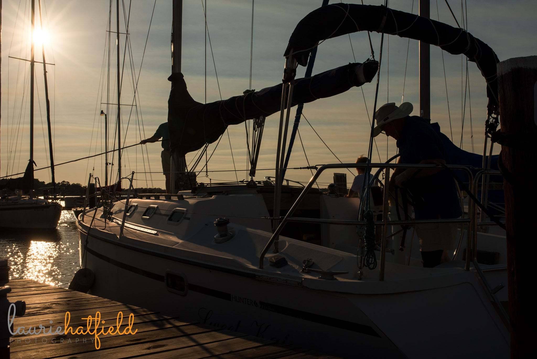 family on sailboat at sunset | Mobile AL photographer