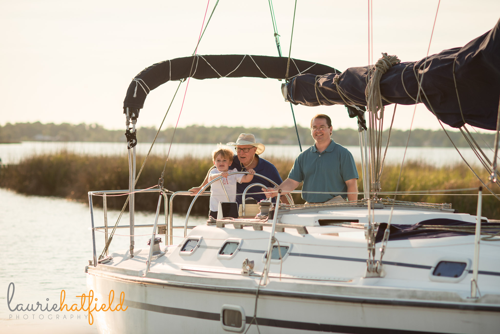 family on sailboat | Mobile AL photographer