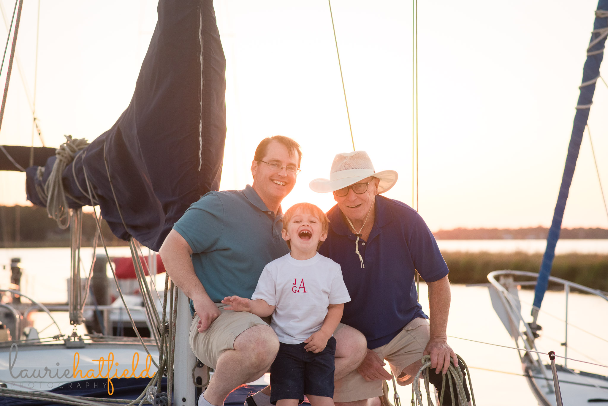 grandfather, dad, and son on sailboat | Mobile AL extended family photo session