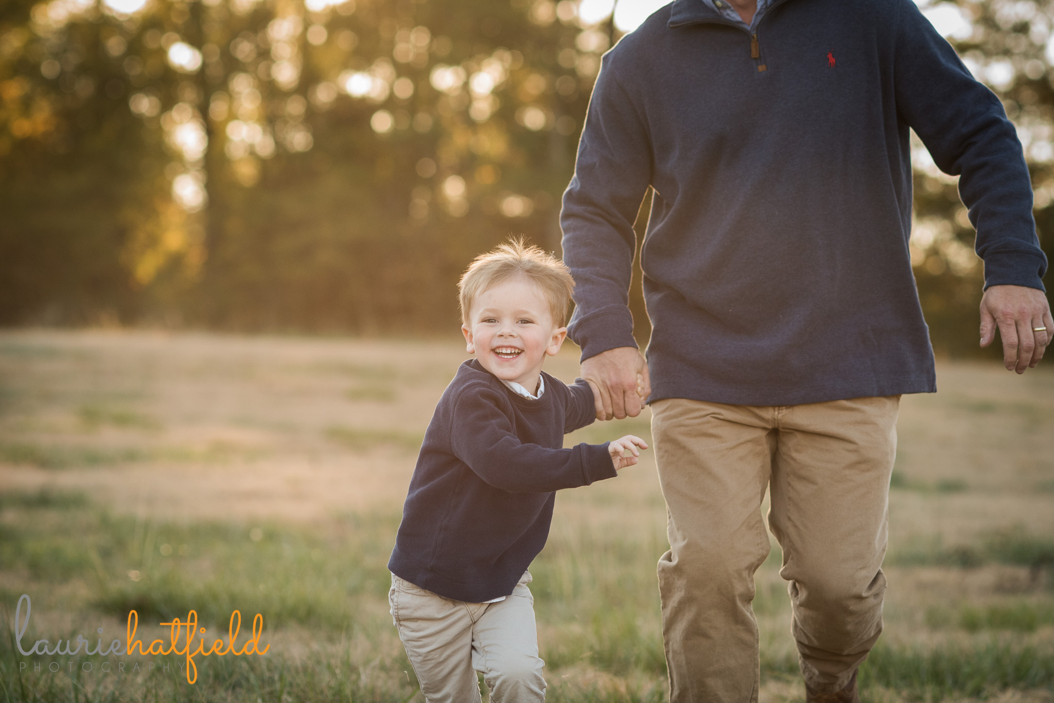3-year-old boy running with dad in field | Mobile AL family photographer