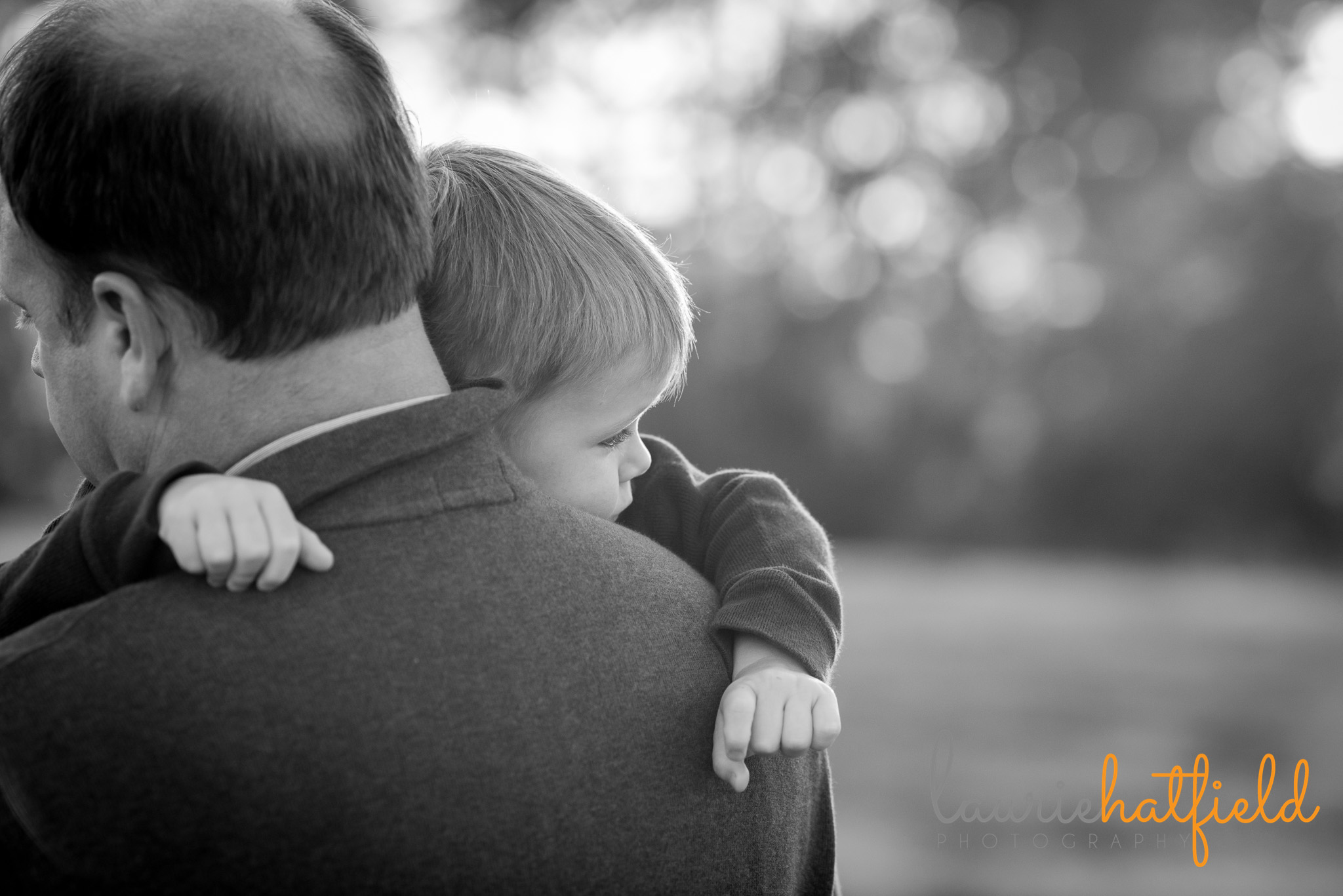 dad holding 3-year-old son | Mobile AL family photographer