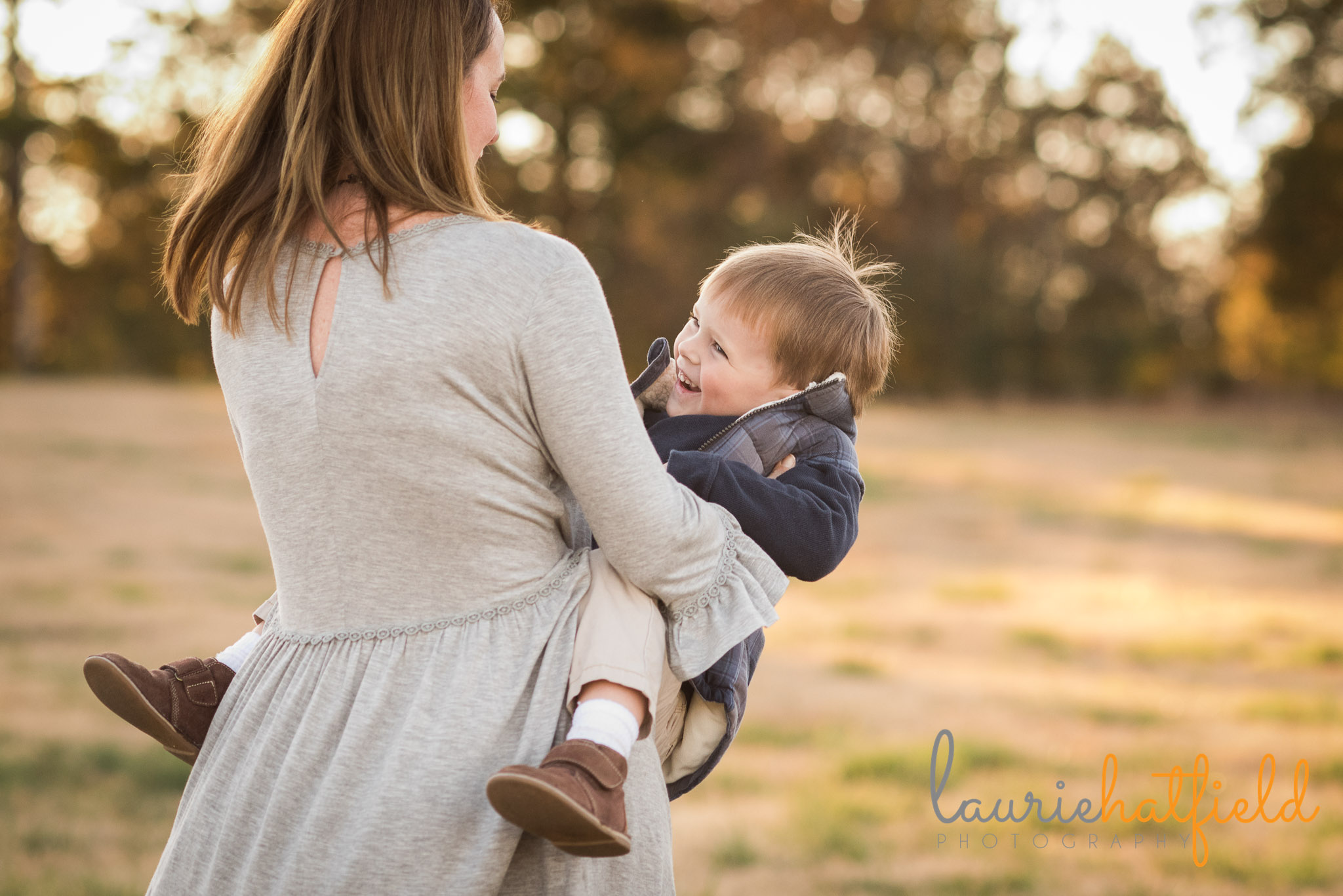 mom twirling with little boy | Mobile AL family photographer
