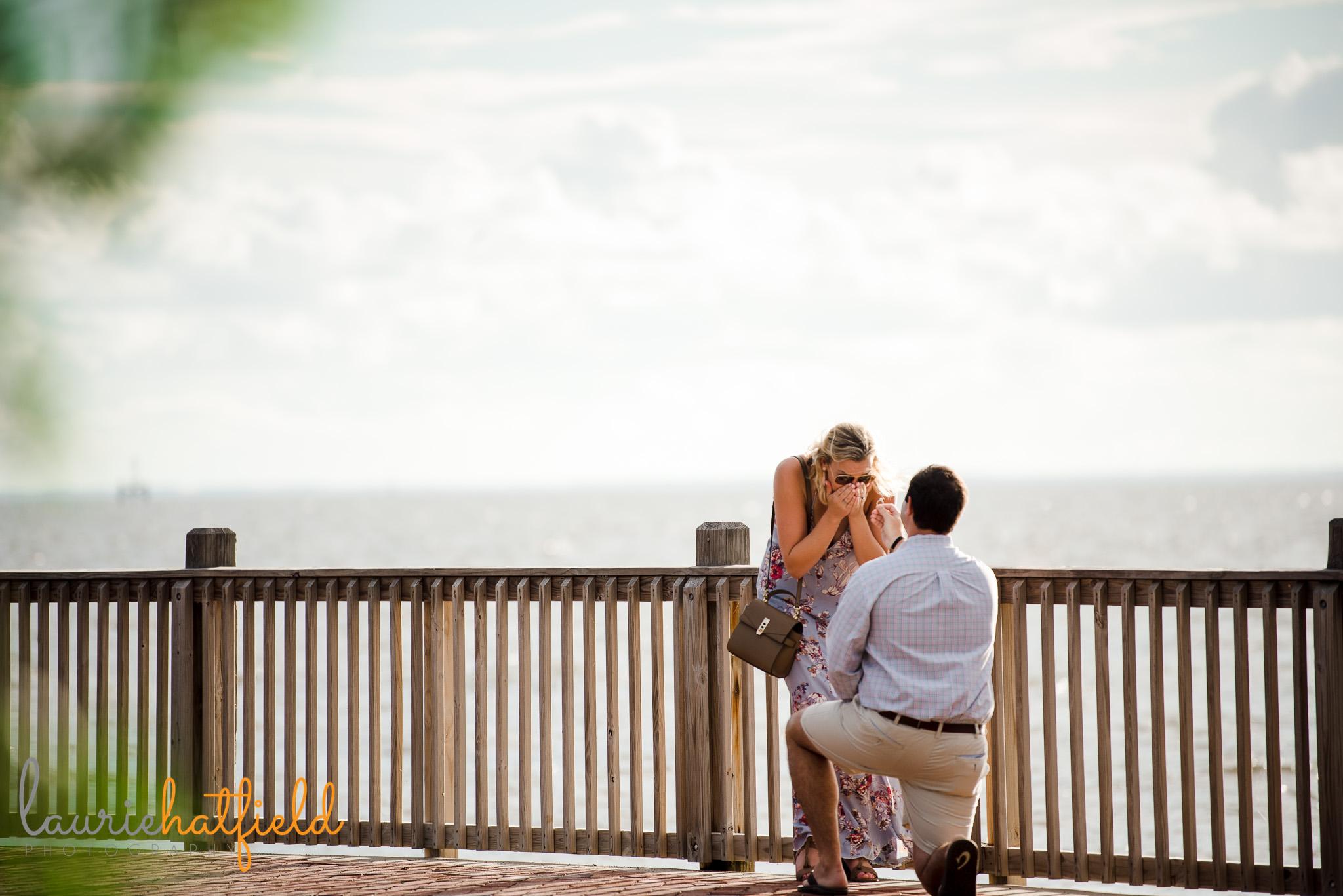 boy proposing near water | Mobile AL proposal photographer