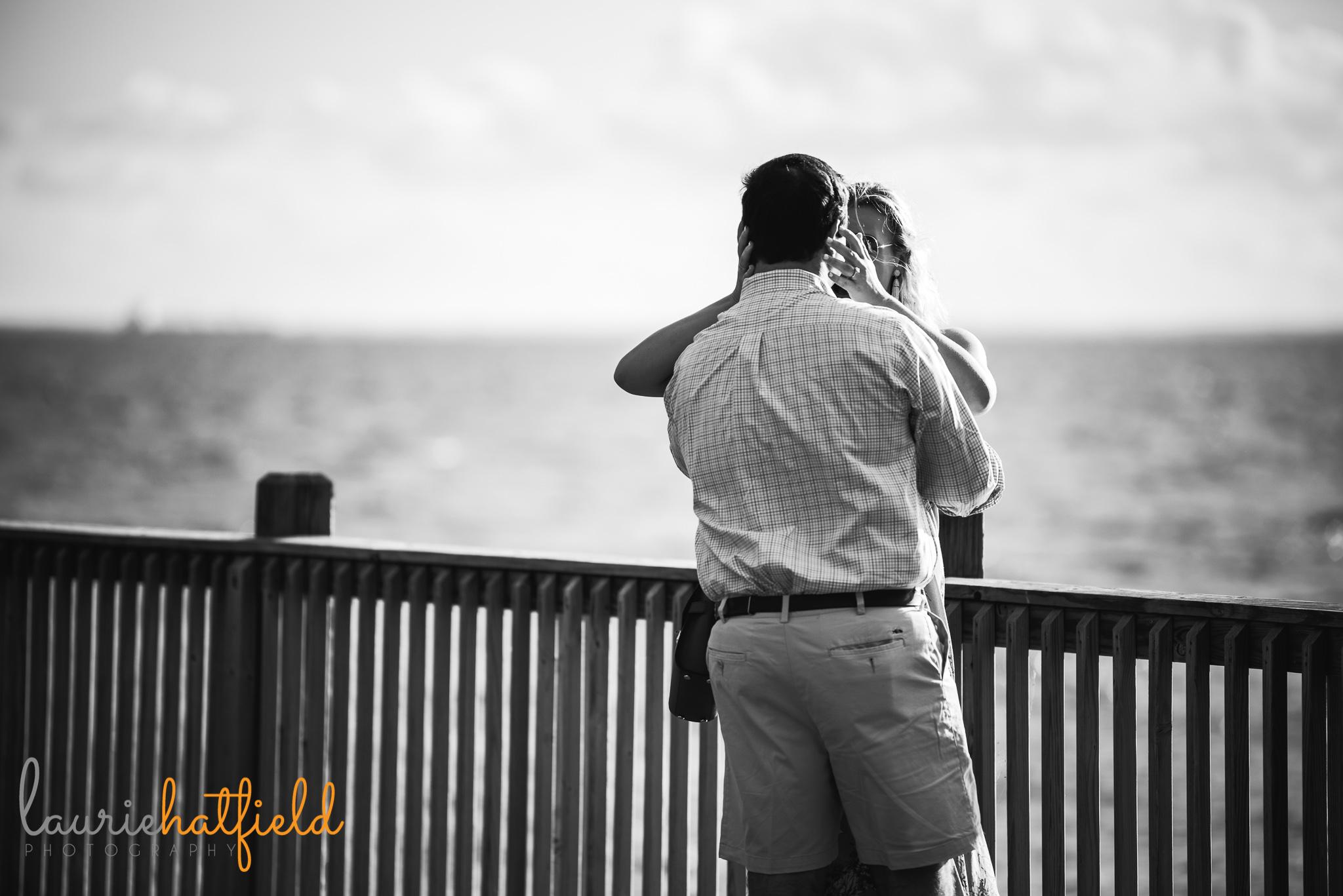 couple embracing after engagement | Mobile AL proposal photographer