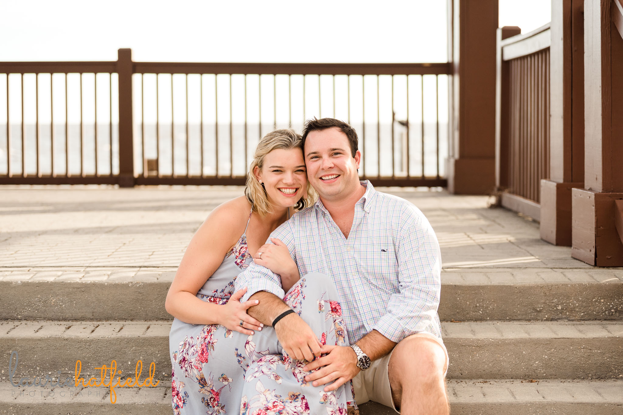 couple sitting together after engagement | Mobile AL proposal photographer