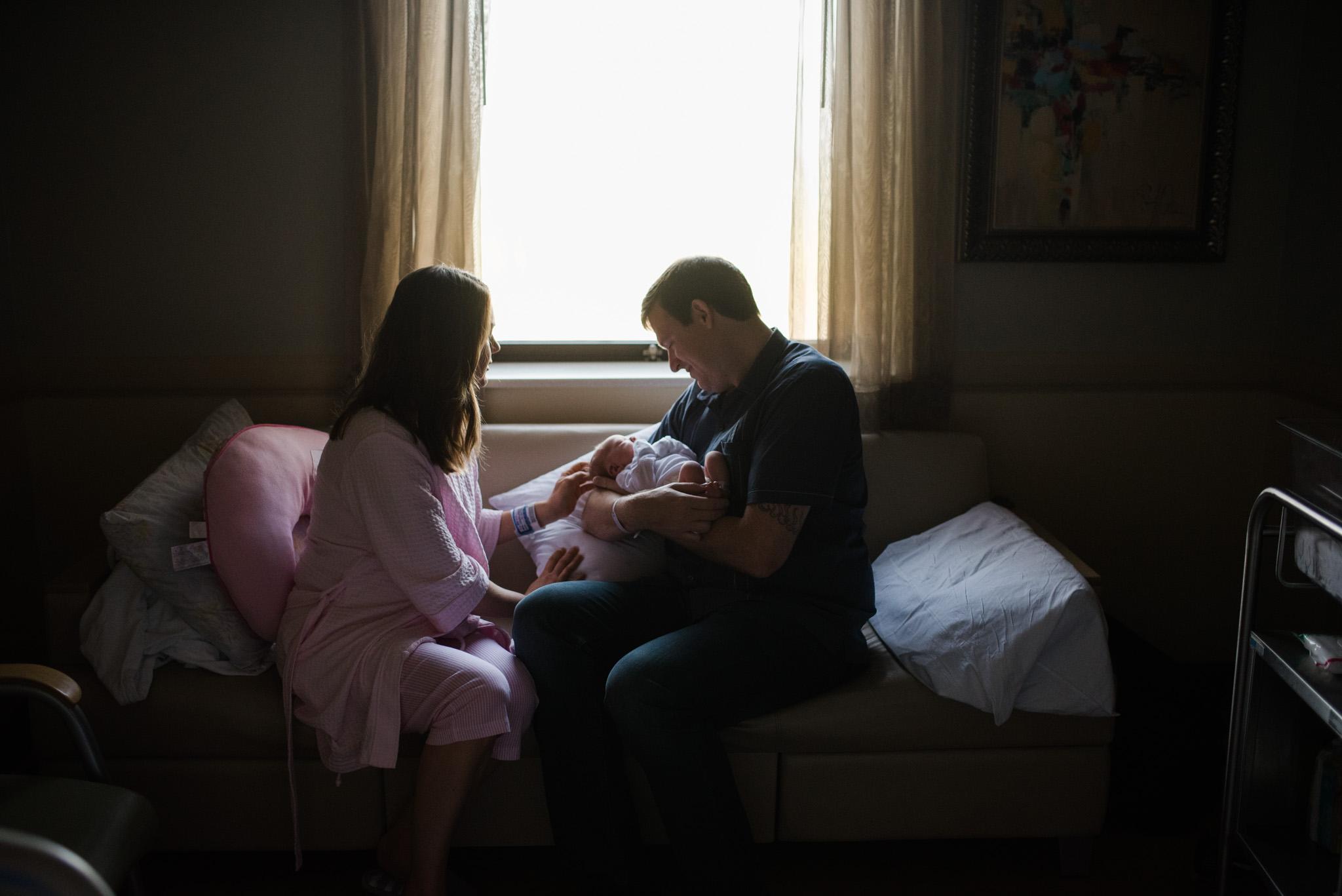 new mom and dad admiring newborn baby girl | Mobile AL Fresh 48 photographer