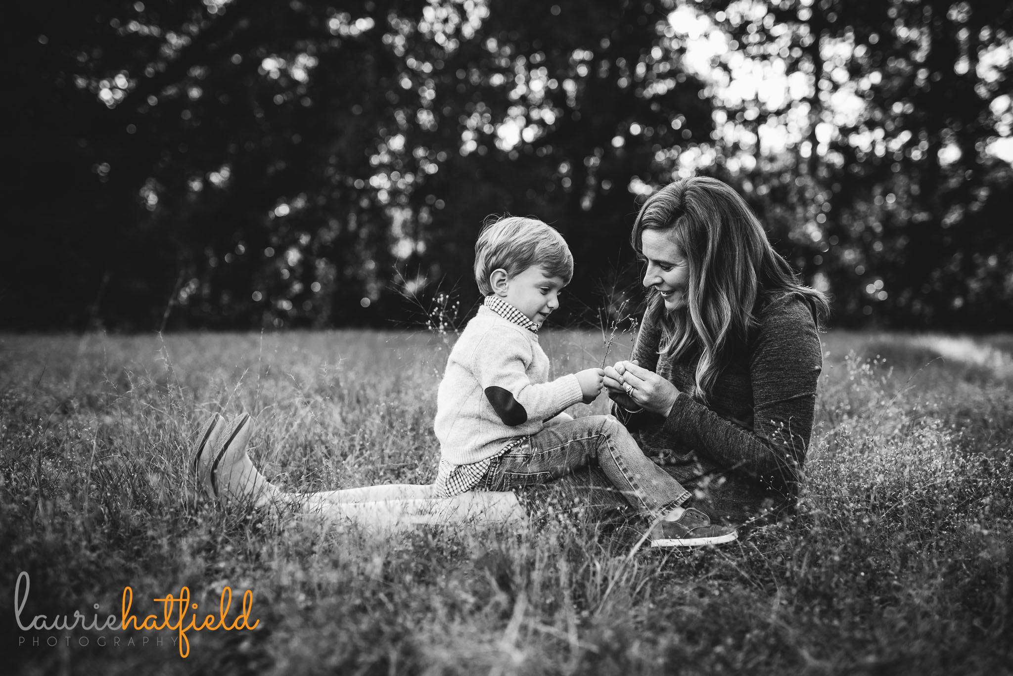 mom sitting in grass with little boy | Mobile AL lifestyle family photographer