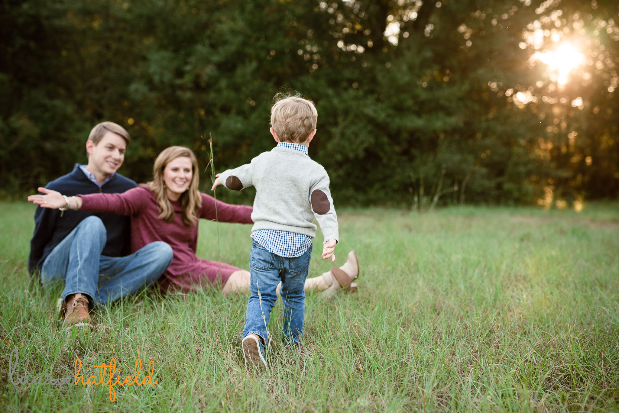 little boy running to parents | Mobile AL family photographer