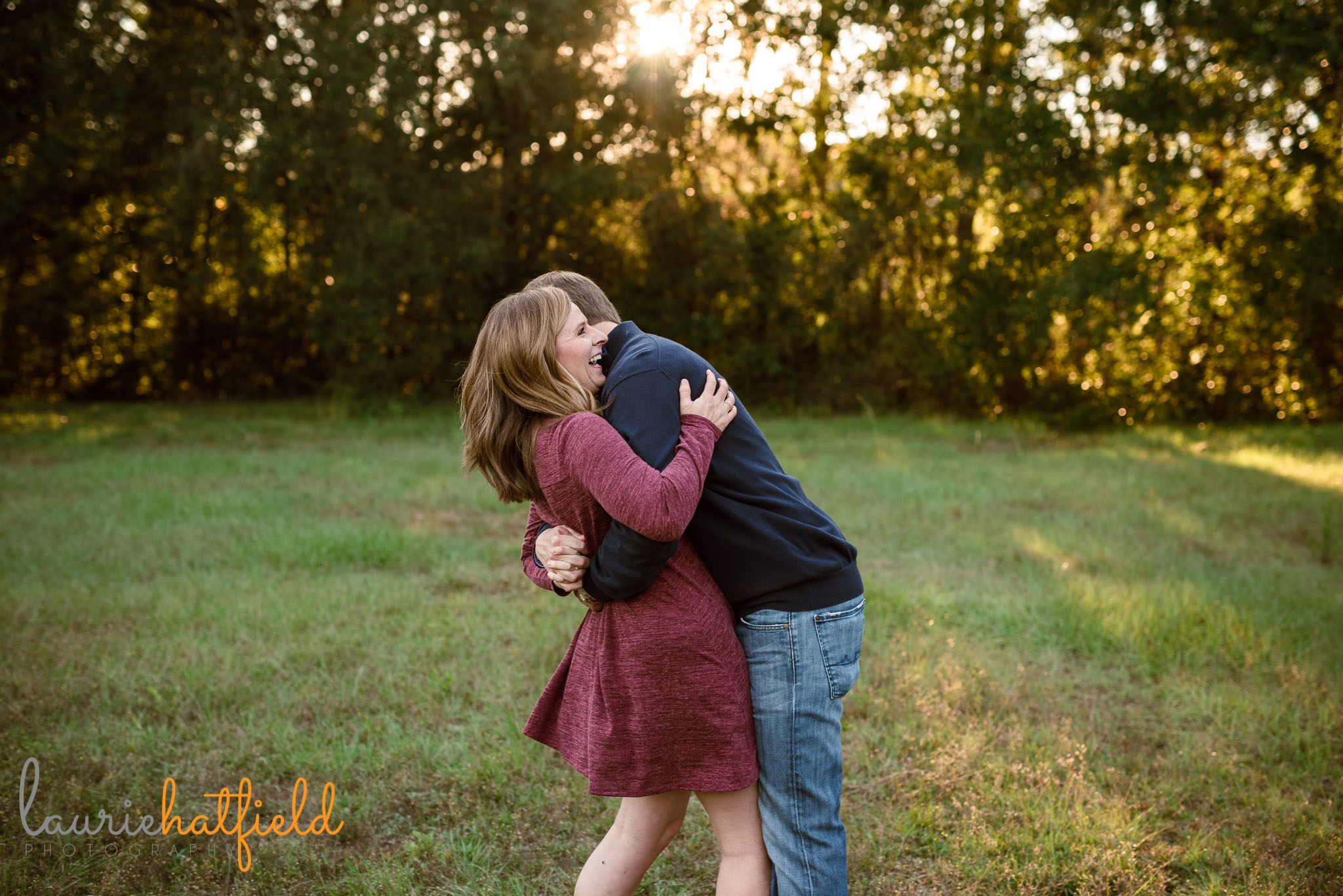 mom and dad hugging | Mobile AL lifestyle family photography