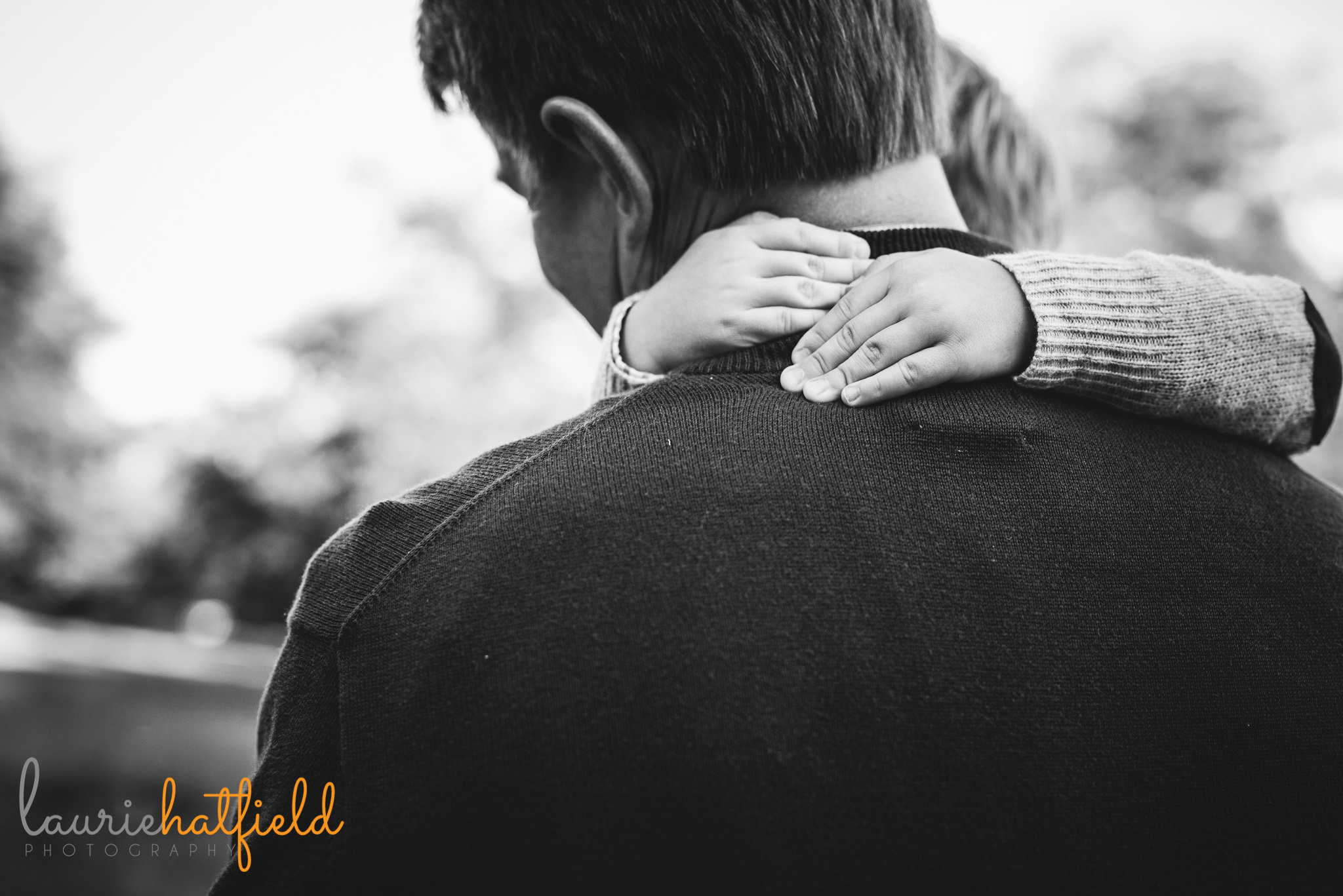 little boy holding onto dad | Mobile AL family photographer