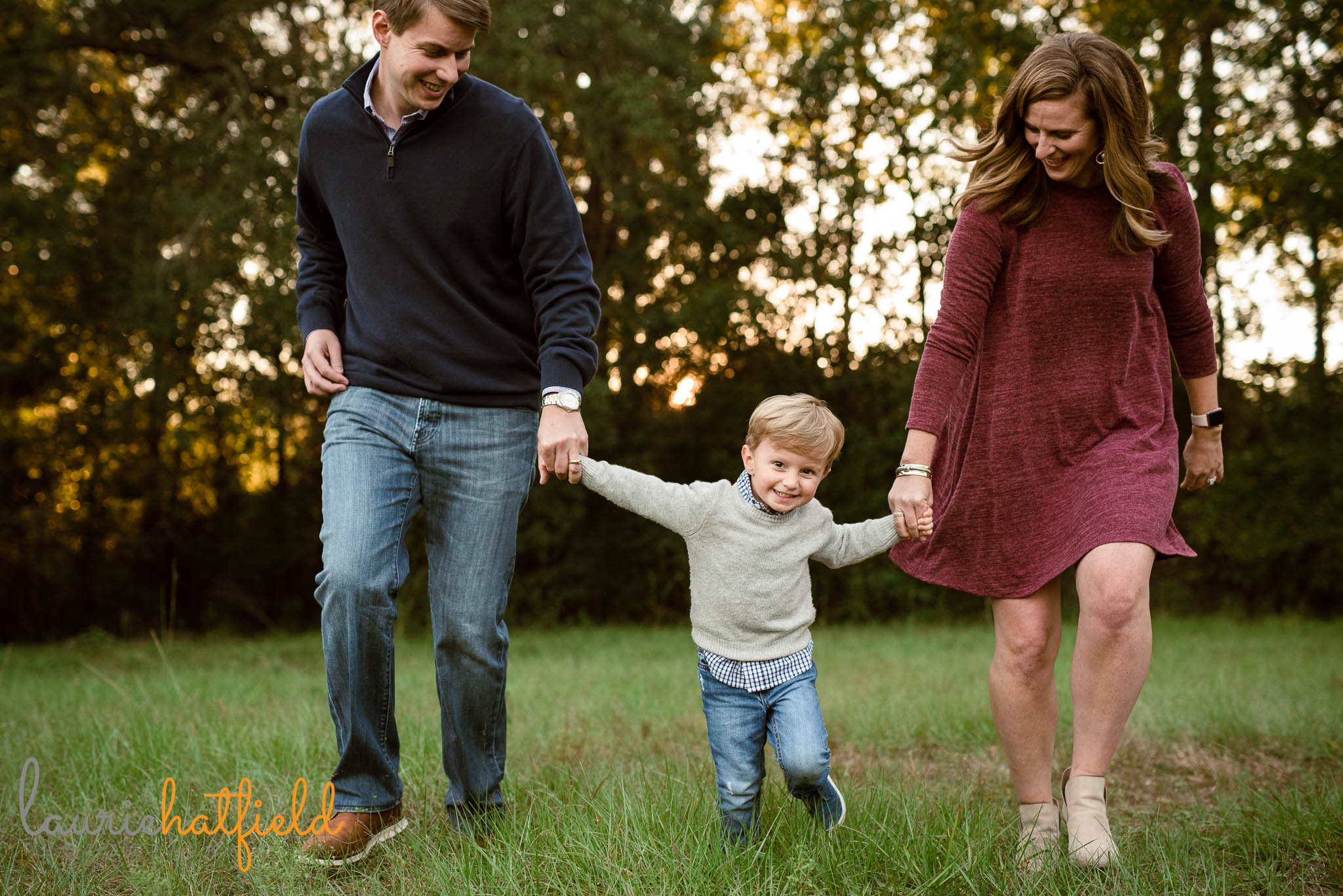 family of three walking in field | Mobile AL lifestyle photographer