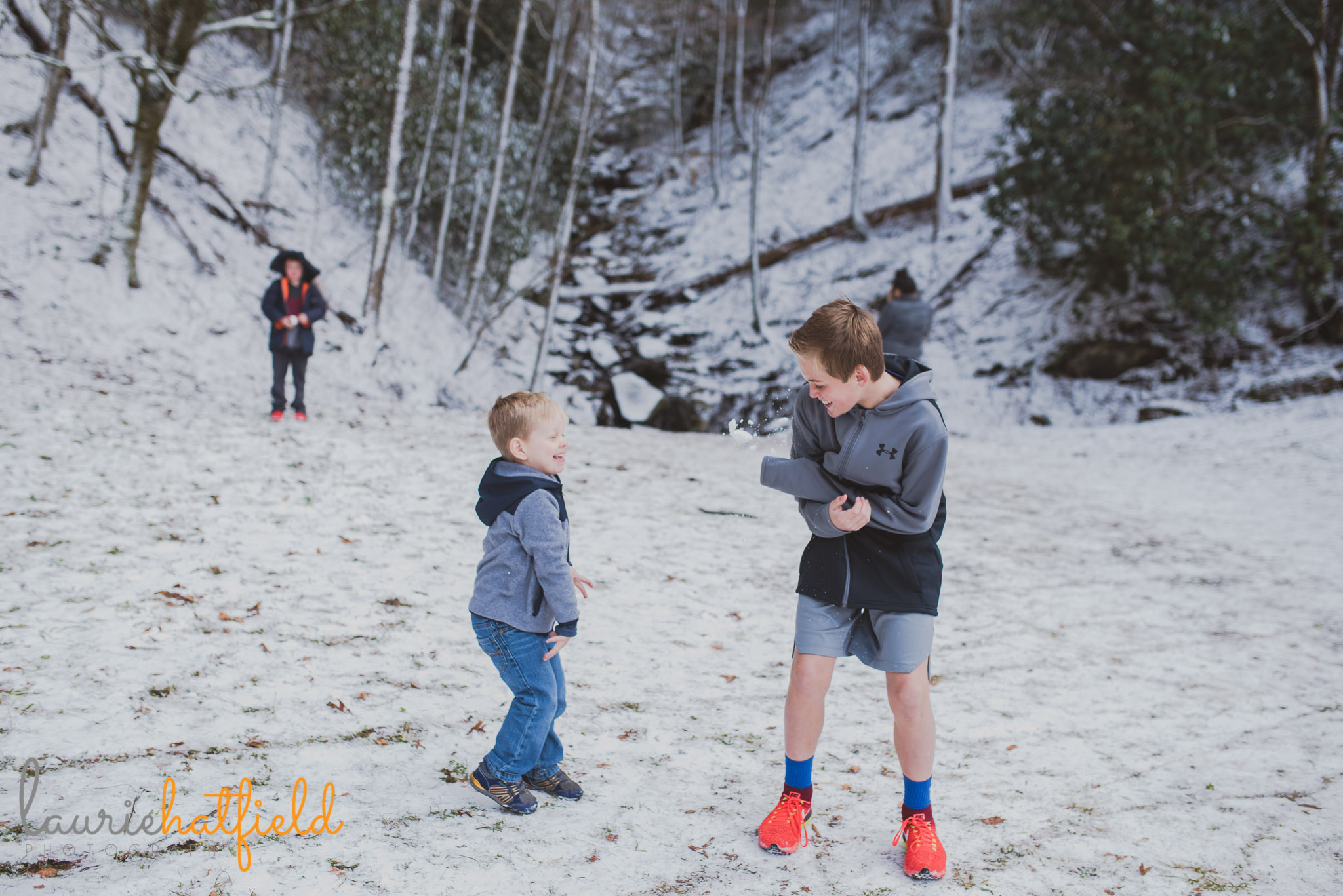 brother throwing snowballs | Mobile AL family photographer